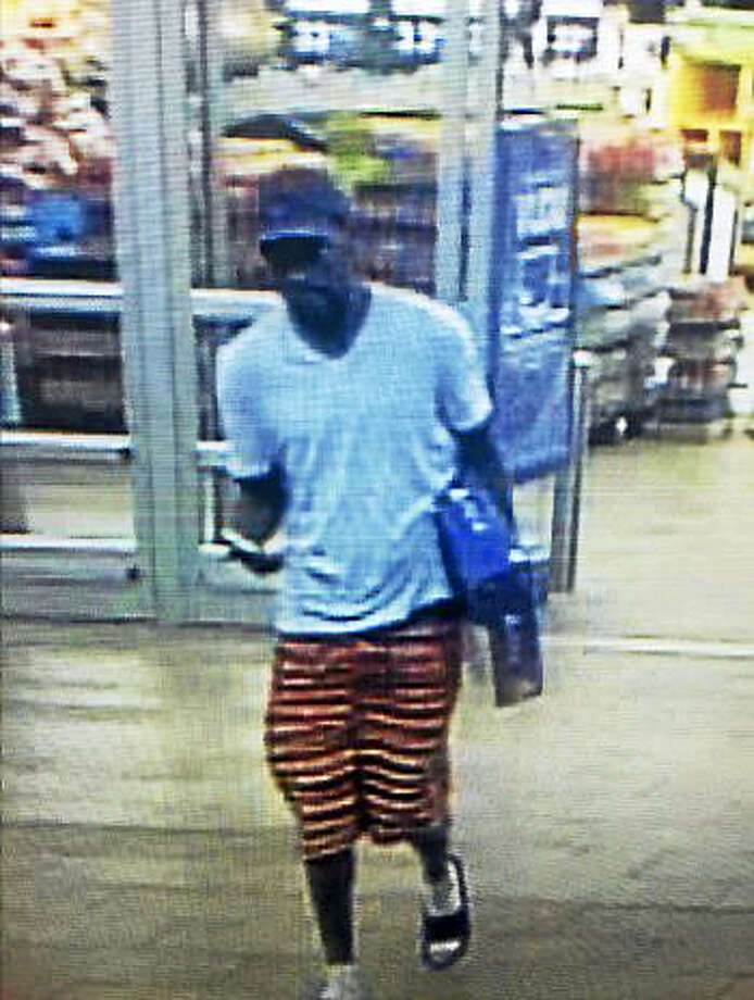Police are looking for help identifying this man and his car, as he is believed to have used a stolen credit card. Photo: Courtesy Of Connecticut State Police