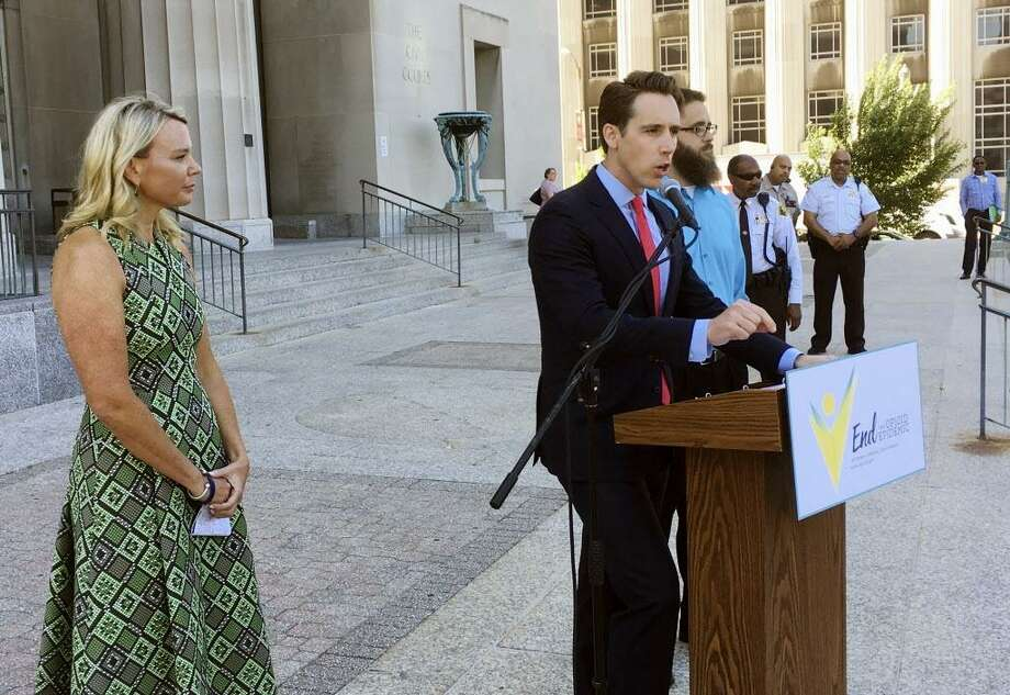 Missouri Attorney General Josh Hawley speaks at a news conference in June, in St. Louis where announced he is suing three large pharmaceutical companies, saying their deceptive marketing practices contributed to an opioid abuse crisis in the state. Looking on at left is Jammie Fabick, whose 17-year-old daughter died of an opioid overdose in 2014. Photo: Jim Salter / Associated Press / Copyright 2017 The Associated Press. All rights reserved.