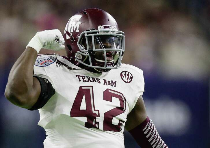 Otaro Alaka of the Texas A&M Aggies flexes his muscles after a defensive stop Kansas State Wildcats during the Texas Bowl on Dec. 28, 2016 in Houston.
