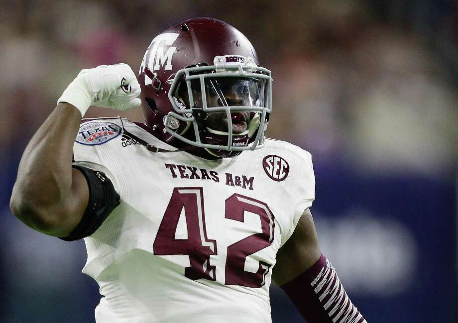 Otaro Alaka of the Texas A&M Aggies flexes his muscles after a defensive stop Kansas State Wildcats during the Texas Bowl on Dec. 28, 2016 in Houston. Photo: Bob Levey /Getty Images / 2016 Getty Images