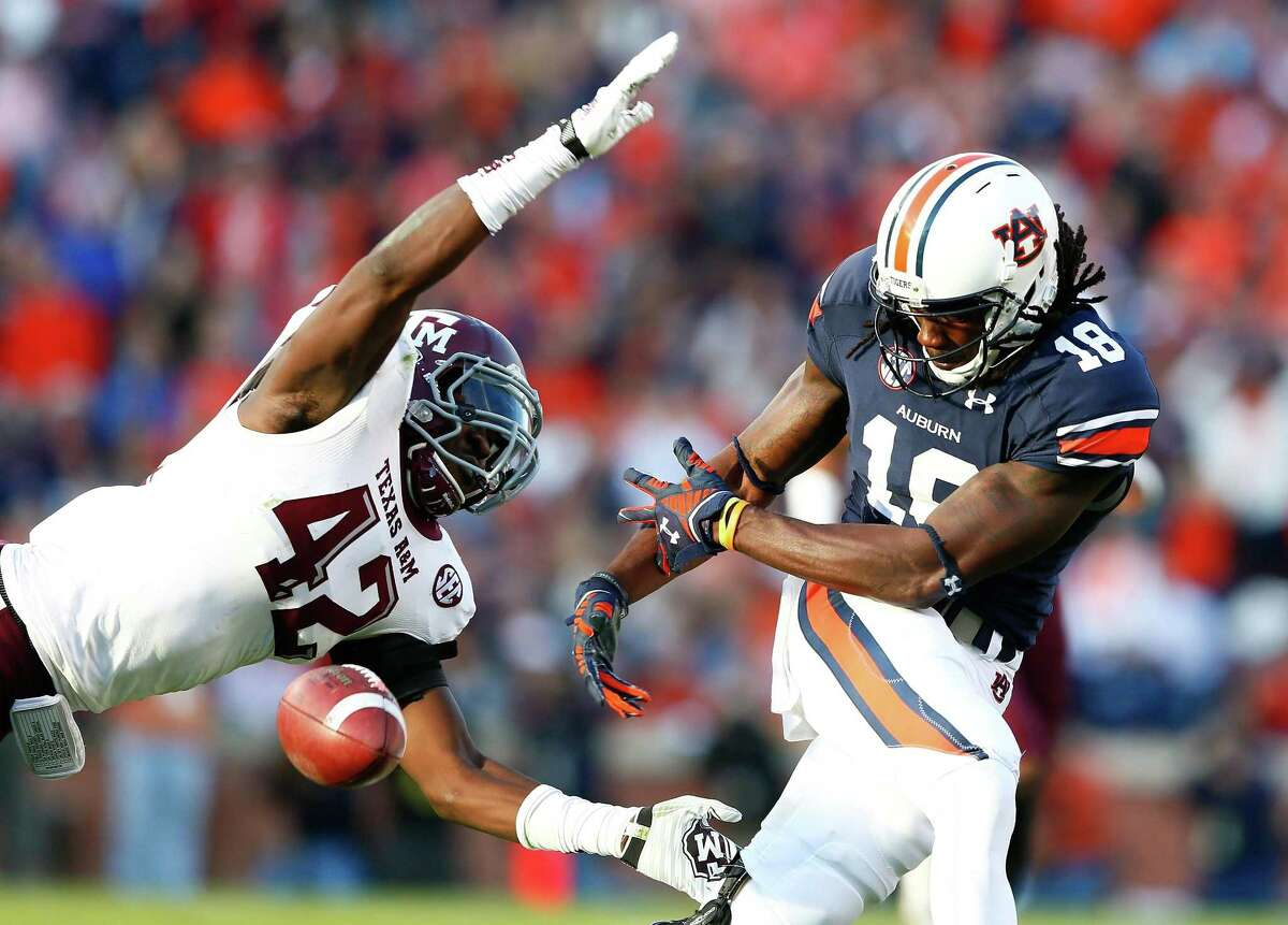 Sammie Coates (right) of the Auburn Tigers fails to pull in this reception against Otaro Alaka of the Texas A&M Aggies at Jordan Hare Stadium on Nov. 8, 2014 in Auburn, Ala.