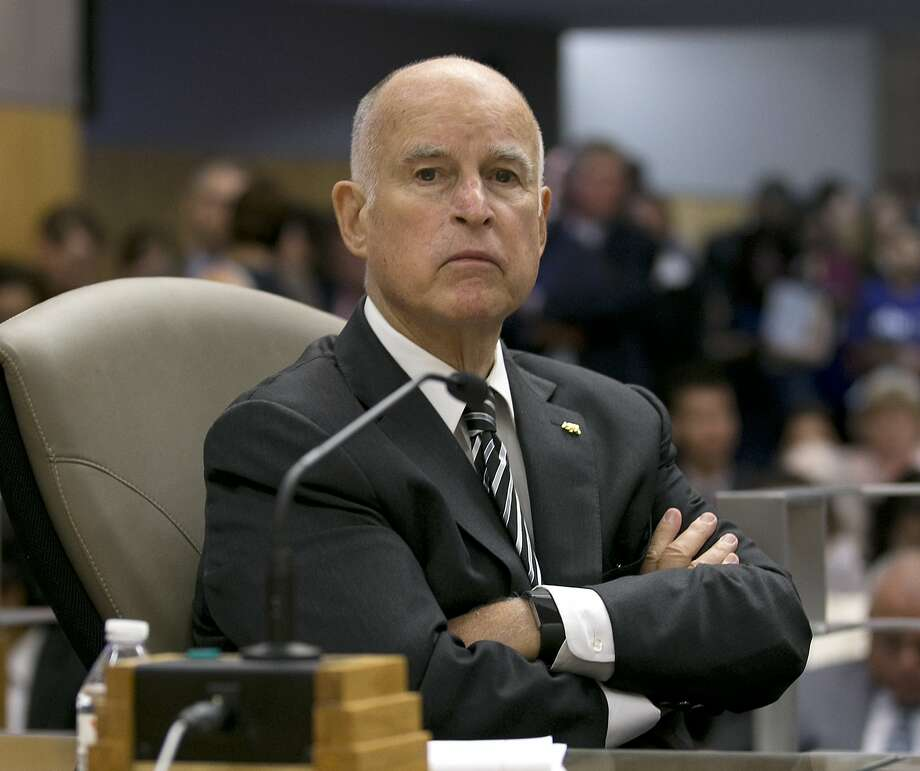 California Gov. Jerry Brown listens as a state Senate committee discusses a pair of climate change bills he supports in Sacramento. Will Brown take up climate issues once he leaves Sacramento? Photo: Rich Pedroncelli, Associated Press