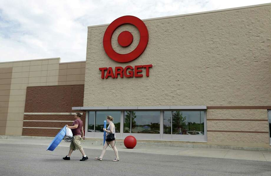 Target's second-quarter sales topped analysts' estimates on Wednesday, and the company boosted its forecast for the rest of the year. That helped soothe investors after a rocky earnings season for retailers, sending Target shares up. Photo: Elise Amendola /Associated Press / AP