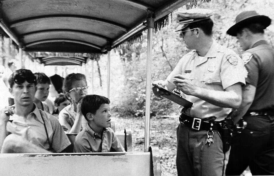 A San Antonio police officer takes statements after the Brackenridge Eagle Line's Old No. 99 was robbed at gunpoint on July 18, 1970. It was believed to be the first train robbery in the United States since 1923 and the first of a miniature train. Now the San Antonio Zoo, which owns the ride, plans to recreate the pop culture event on its 50th anniversary as a fundraiser. Photo: /EXPRESS NEWS FILE PHOTO / SAN ANTONIO EXPRESS-NEWS