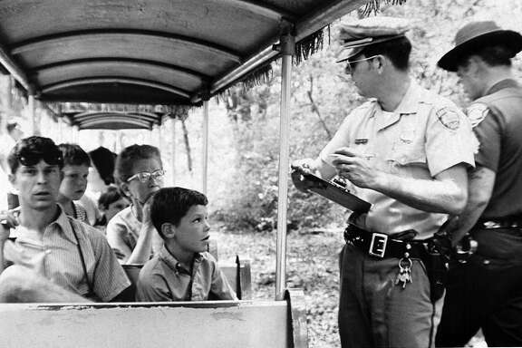 A San Antonio police officer takes statements after the Brackenridge Eagle Line's Old No. 99 was robbed at gunpoint on July 18, 1970. It was believed to be the first train robbery in the United States since 1923 and the first of a miniature train. Now the San Antonio Zoo, which owns the ride, plans to recreate the pop culture event on its 50th anniversary as a fundraiser.