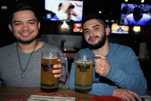 Rocky Ortiz and Alonso Garcia are having a beer at Anchor Bar. Photo By: Xelina Flores