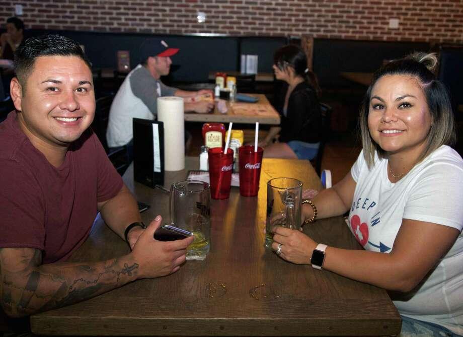 Aaron and Jaime Escalante enjoy an evening at Anchor Bar. Photo: Xelina Flores /For The Express-News