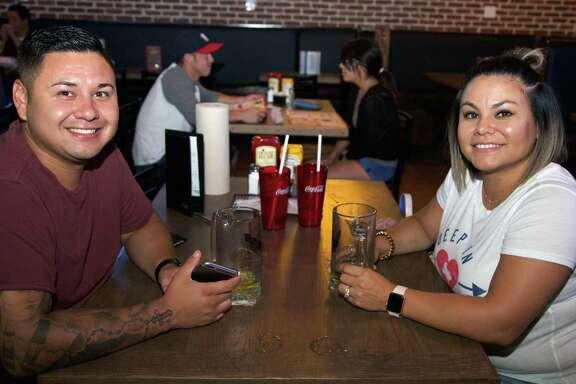 Aaron and Jaime Escalante enjoy an evening at Anchor Bar.
