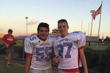 Lumberton High School football player Juan Trevino Jr., left, was airlifted to a Galveston hospital Friday evening after collapsing during practice.
