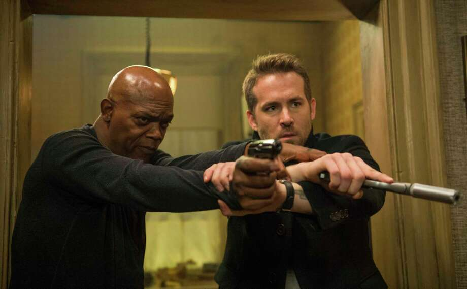 "This image released by Lionsgate shows Samuel L. Jackson, left, and Ryan Reynolds in ""The Hitman's Bodyguard."" (Jack English/Lionsgate via AP) ORG XMIT: NYET862 Photo: Jack English / Cortesy of Summit Entertainment and Millenium Media."