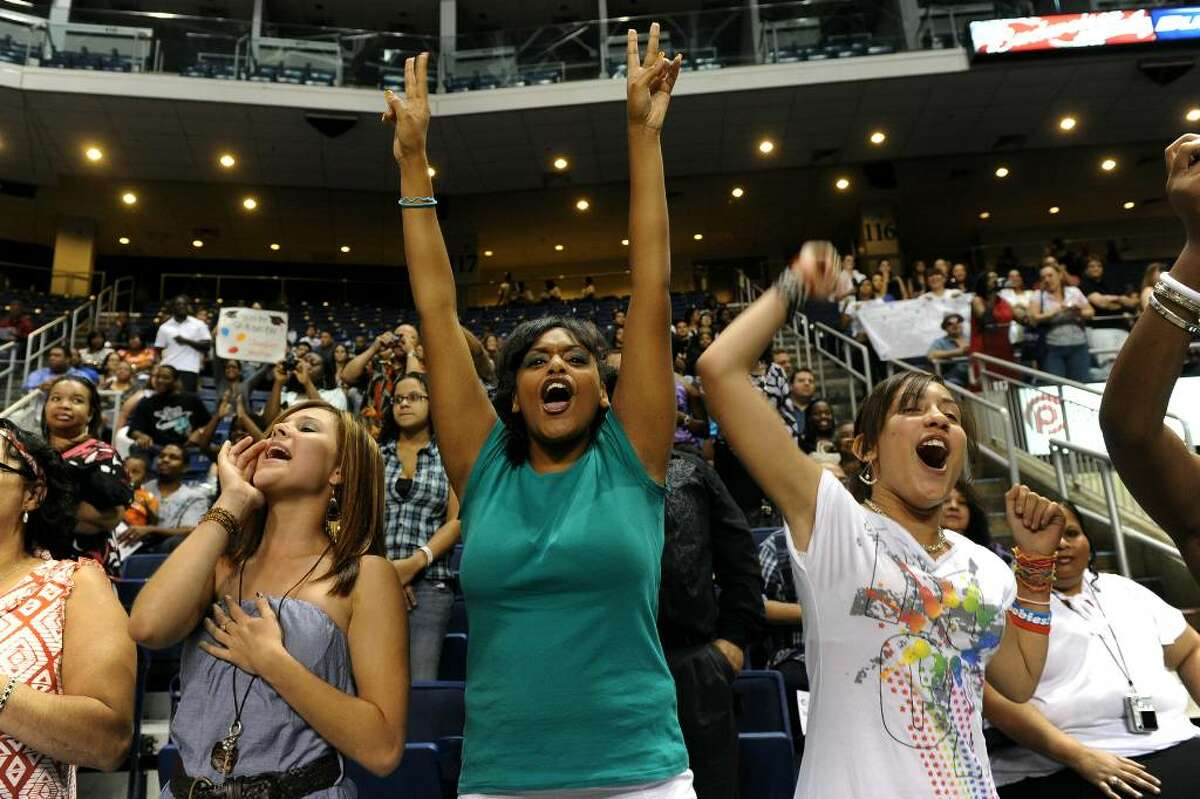 Family members cheer for graduate Mayte Torres at the start of Central High School's Graduation Exercises at the Arena at Harbor Yard in downtown Bridgeport, Conn. on Thursday June 17, 2010. From left to right is Viviane Santiago, 17, Eliza Fernandez, 18, and Joceline Hagan, 12.