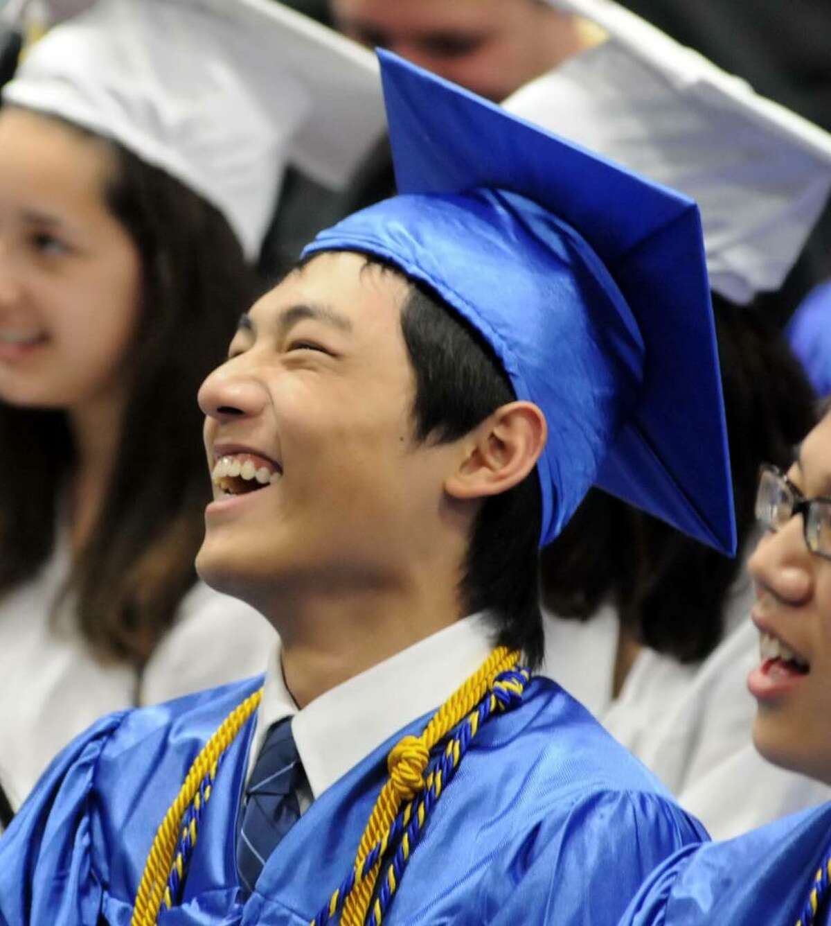 Newtown High School held their graduation ceremony on Thursday June 17, 2010, at the O'Neill Center at Western Connecticut State University. Wending Lu, 18, enjoys a hardy laugh during a speech.
