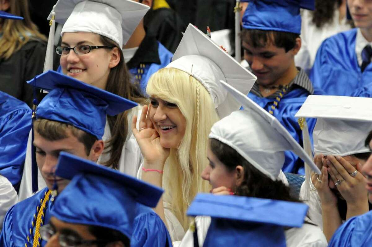 Newtown High School held their graduation ceremony on Thursday June 17, 2010, at the O'Neill Center at Western Connecticut State University. Katy Bloxsom, center, enjoys a laugh during the ceremonies.