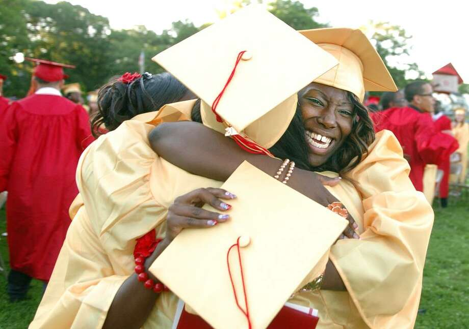 Paris Forney hugs fellow graduate Latrice Davis following the 2010 Stratford High School Commencement Ceremony Thursday June 17 at Penders Field. Photo: Autumn Driscoll / Connecticut Post
