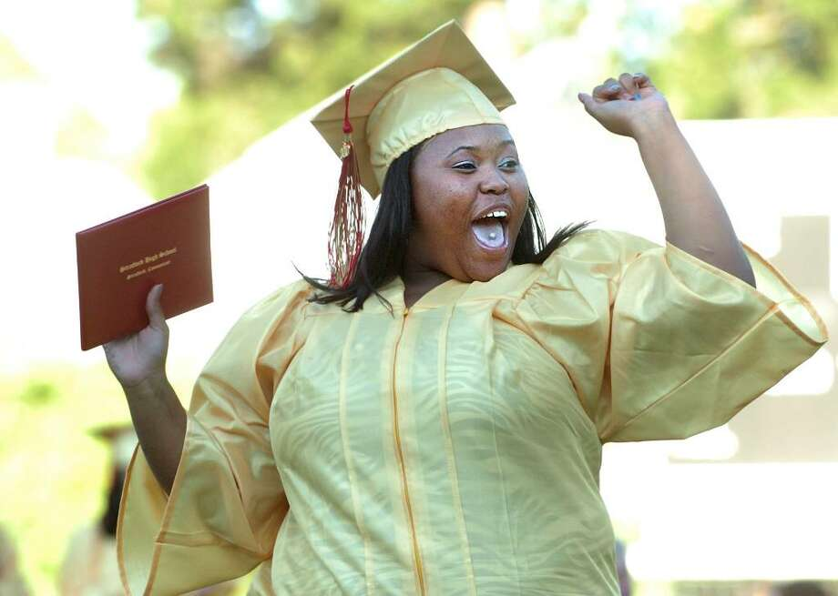 Latrice Davis cheers after accepting her diploma during the 2010 Stratford High School Graduation Ceremony Thursday June 17 at Penders Field. Photo: Autumn Driscoll / Connecticut Post