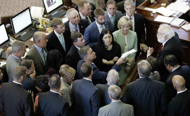 """Members of the Texas House discuss a point of order, Tuesday in Austin. The transgender """"bathroom bill"""" fails again as the special session ended a day early on Tuesday."""