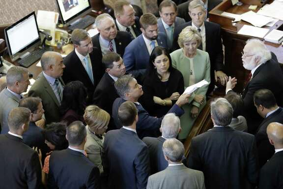 "Members of the Texas House discuss a point of order, Tuesday in Austin. The transgender ""bathroom bill"" fails again as the special session ended a day early on Tuesday."