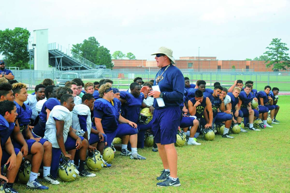 Klein Collins head coach Drew Svoboda gathers the team for a post-practice discussion Monday, May 9, 2016 at Klein Collins High School. Svoboda says this team is one of the most cohesive teams he has ever coached.