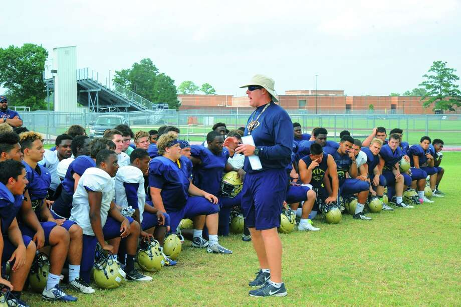 Klein Collins head coach Drew Svoboda gathers the team for a post-practice discussion Monday, May 9, 2016 at Klein Collins High School. Svoboda says this team is one of the most cohesive teams he has ever coached. / Tony Gaines