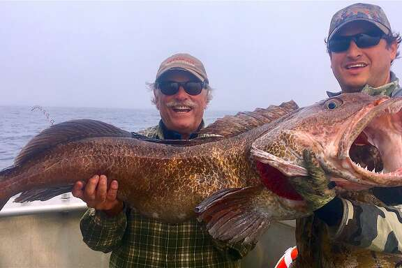 Yancey Forrest-Knowles, on left, ventured to Sitka, Alaska for a chance of what is not typically available in California, such as this 70-pound lingcod