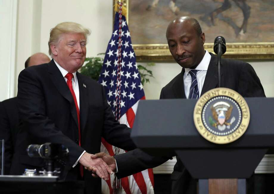 President Donald Trump shakes hands with Merck CEO Ken Frazier in happier days. Frazier resigned from Trump's manufacturing council and the president disbanded the group and another advisory panel after several CEOs defected over his handling of the neo-Nazi protest in Charlottesville. Photo: Alex Brandon /Associated Press / Copyright 2017 The Associated Press. All rights reserved.