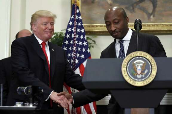 President Donald Trump shakes hands with Merck CEO Ken Frazier in happier days. Frazier resigned from Trump's manufacturing council and the president disbanded the group and another advisory panel after several CEOs defected over his handling of the neo-Nazi protest in Charlottesville.