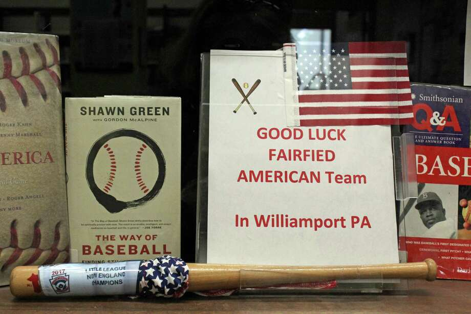 Even the town's libraries are getting into the Little League World Series. A display at the Fairfield Woods Branch wishes the local team good luck. Photo: Genevieve Reilly / Hearst Connecticut Media / Fairfield Citizen