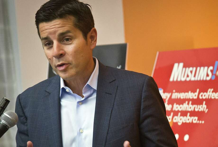 FILE - In this June 25, 2015, file photo, Muslim comedian Dean Obeidallah speaks at a news conference in New York. Obeidallah, a Muslim-American radio host, is accusing Andrew Anglin, the publisher of a notorious neo-Nazi website, of defaming him by falsely labeling him the �mastermind� of a deadly concert bombing in England, according to a federal lawsuit filed Wednesday, Aug. 16, 2017. (AP Photo/Bebeto Matthews, File) Photo: Bebeto Matthews, Associated Press