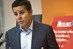 FILE - In this June 25, 2015, file photo, Muslim comedian Dean Obeidallah speaks at a news conference in New York. Obeidallah, a Muslim-American radio host, is accusing Andrew Anglin, the publisher of a notorious neo-Nazi website, of defaming him by falsely labeling him the �mastermind� of a deadly concert bombing in England, according to a federal lawsuit filed Wednesday, Aug. 16, 2017. (AP Photo/Bebeto Matthews, File)