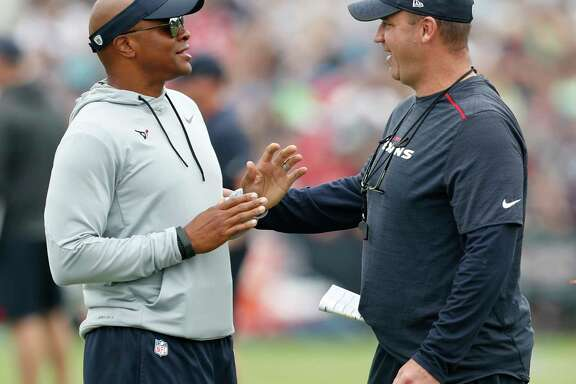 Houston Texans general manager Rick Smith, left, talks to Hhead coach Bill O'Brien during a joint practice between the Texans and the New England Patriots at training camp at The Greenbrier on Tuesday, Aug. 15, 2017, in White Sulphur Springs, W.Va.
