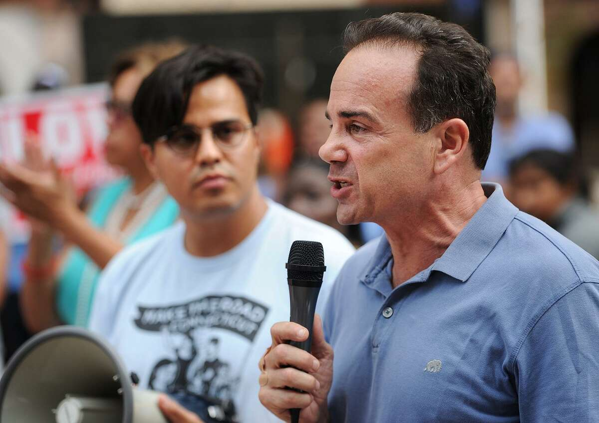 Bridgeport Mayor Joe Ganim addresses a rally on McLevy Green in Bridgeport on Sunday in response to the tragic events that took place in Charlottesville, Va. Following President Trump's blaming