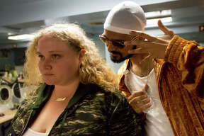 """This image released by Fox Searchlight shows Danielle Macdonald, left, and Siddharth Dahanajay in """"Patti Cake$."""" (Jeong Park/Fox Searchlight via AP)"""
