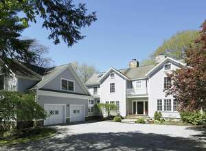 The gray custom-built colonial farmhouse at 328 Wilton Road was built in 1991 blending vintage accents with modern amenities.