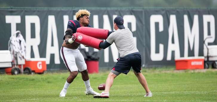 Houston Texans inside linebacker Benardrick McKinney (55) works with linebackers coach Bobby King during a joint practice between the Texans and the New England Patriots at training camp at The Greenbrier on Wednesday, Aug. 16, 2017, in White Sulphur Springs, W.Va.