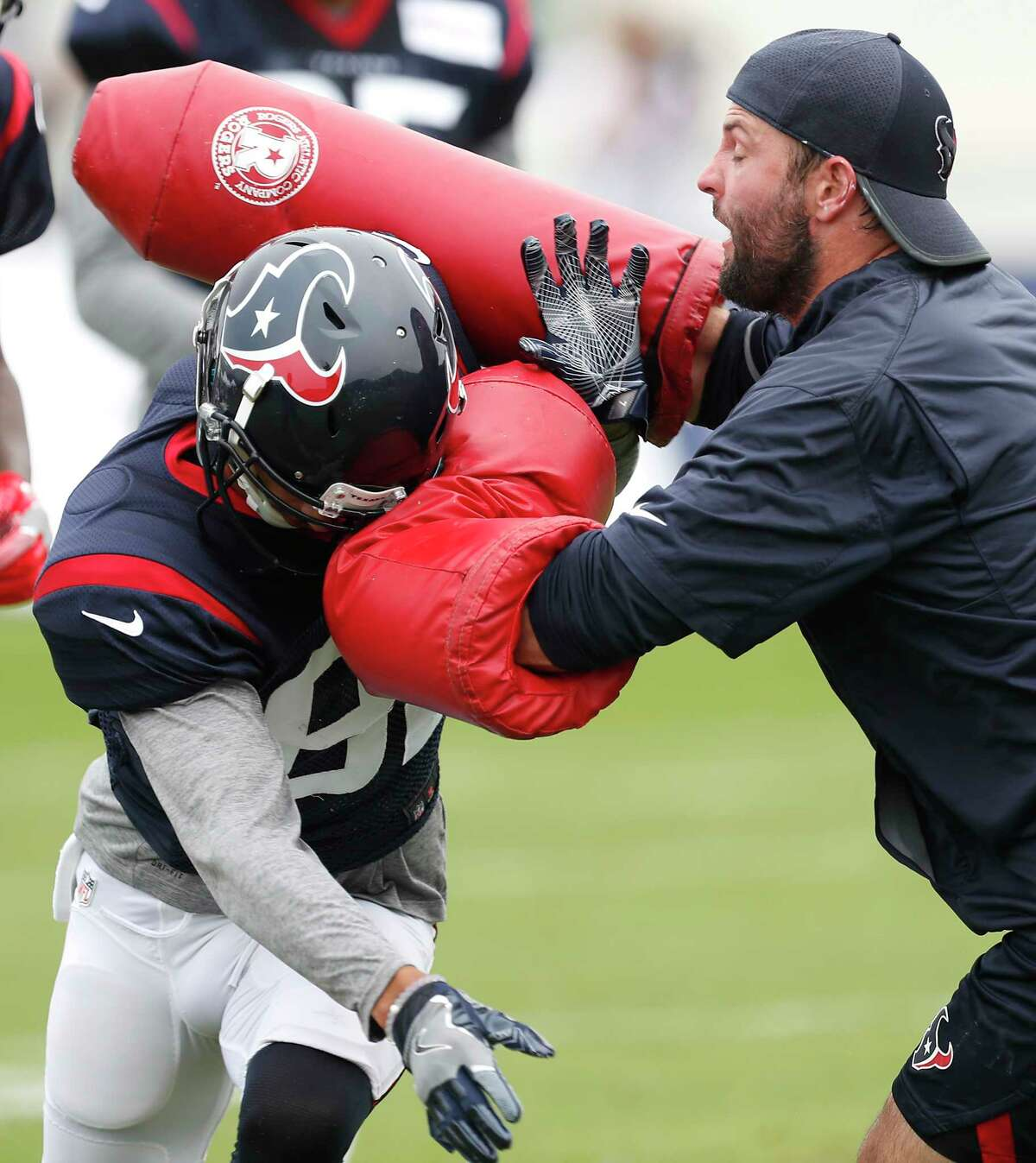 Houston Texans wide receiver Wendall Williams (82) runs a drill with offensive assistant Wes Welker during a joint practice between the Texans and the Patriots at training camp at The Greenbrier on Wednesday, Aug. 16, 2017, in White Sulphur Springs, W.Va.