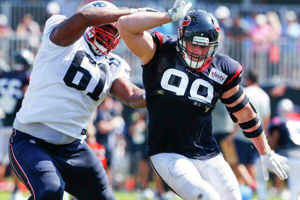 Houston Texans defensive end J.J. Watt (99) runs a pass rush drill against New England Patriots offensive tackle Marcus Cannon (61) during a joint practice between the Texans and the Patriots at training camp at The Greenbrier on Wednesday, Aug. 16,  2017, in White Sulphur Springs, W.Va.