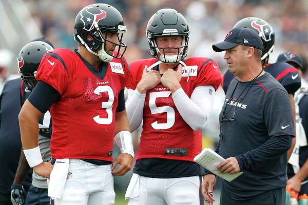 Houston Texans head coach Bill O'Brien talks to Houston Texans quarterbacks Tom Savage (3) and Brandon Weeden (5) during a joint practice between the Texans and the New England Patriots at training camp at The Greenbrier on Wednesday, Aug. 16,  2017, in White Sulphur Springs, W.Va.