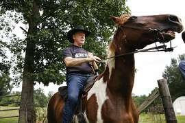 "Former Alabama Chief Justice and U.S. Senate candidate Roy Moore, rides in on a horse named ""Sassy"" to vote a the Gallant Volunteer Fire Department, during the Alabama Senate race, Tuesday, Aug. 15, 2017, in Gallant, Ala. (AP Photo/Brynn Anderson)"