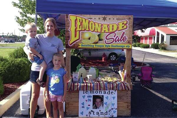 Sarah Deatherage with her children Camden and Kaylee at their lemonade stand.