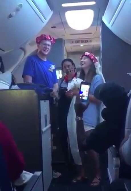 Texas newlyweds, Taylor and Mikaelea Flowers, got a literal up date to their wedding recently, aboard a Southwest Airlines flight.
