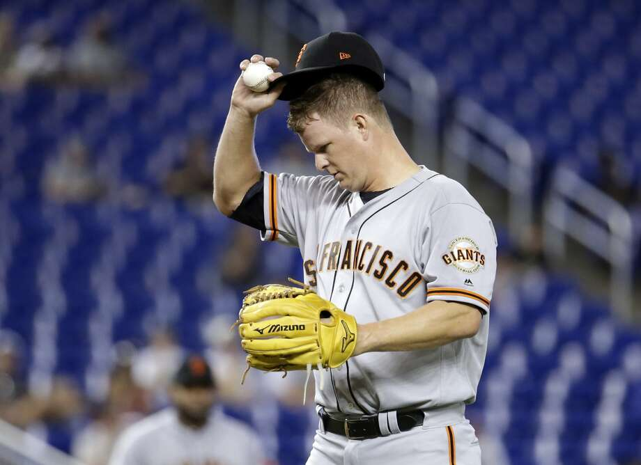 San Francisco Giants starting pitcher Matt Cain adjusts his cap during the first inning of a baseball game against the Miami Marlins, Wednesday, Aug. 16, 2017, in Miami. (AP Photo/Lynne Sladky) Photo: Lynne Sladky, Associated Press