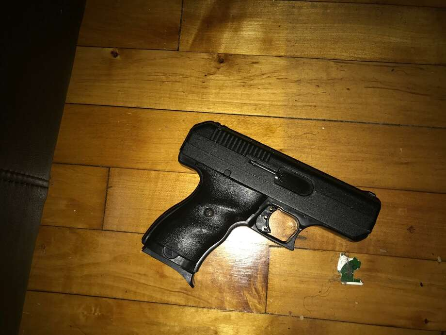 A convicted felon, Terrence Voss was found with a handgun and fentanyl-laced heroin packaged for sale during a search warrant execution by narcotics officers, police said. Photo: Contributed Photo / Norwalk Police Department
