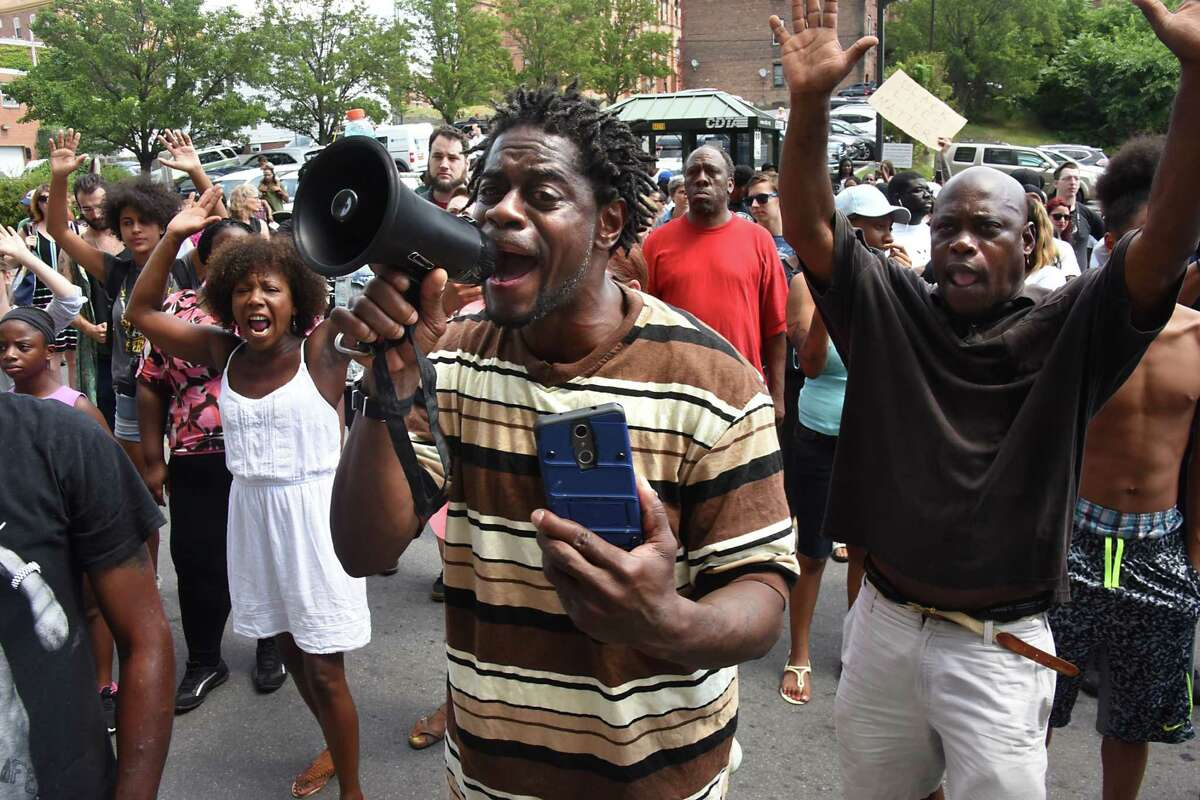 William Felder of Troy leads a chant of
