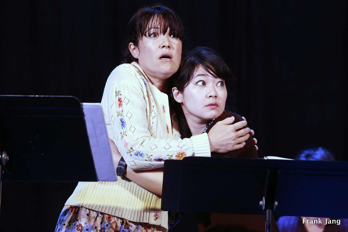 """From left:�Madame Ho's daughter Daisy (Lisa Hori-Garcia)�and servant girl Mui (Monica Ho) huddle for safety in a staged reading of Eugenie Chan Theater Projects' """"Madame Ho"""" in May 2016."""