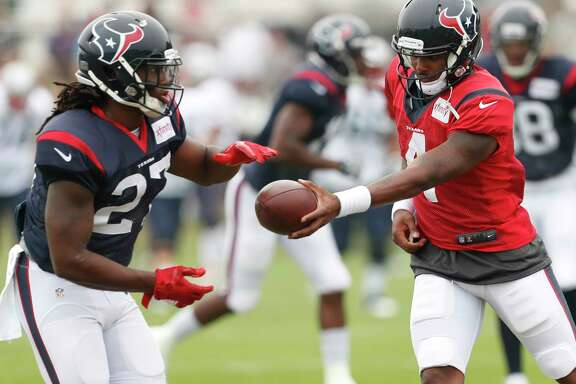 Houston Texans running back D'Onta Foreman (27) takes a hand off from quarterback Deshaun Watson (4) during a joint practice between the Texans and the Patriots at training camp at The Greenbrier on Wednesday, Aug. 16,  2017, in White Sulphur Springs, W.Va. ( Brett Coomer / Houston Chronicle )