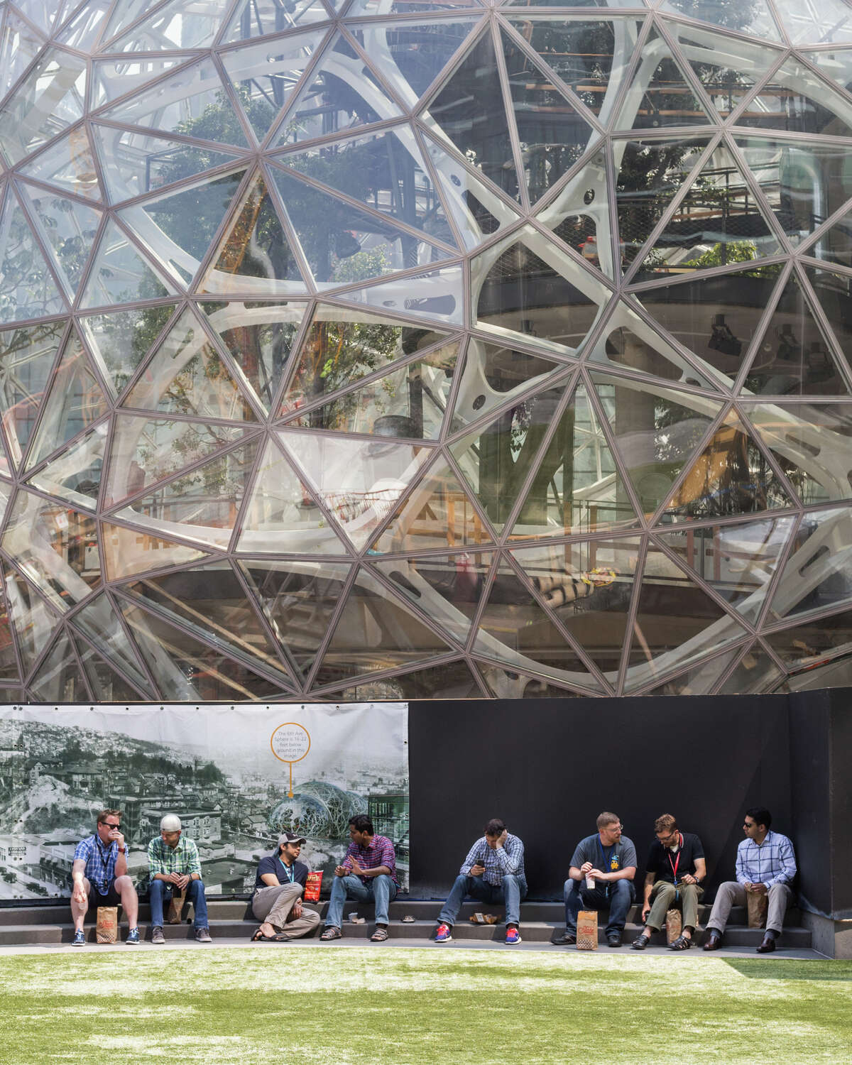 Amazonians eat lunch under the spheres on Aug. 10, 2017.