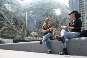 Glynis Moore and Chelsea Ghant of Amazon eat lunch outside the spheres on Aug. 10, 2017.