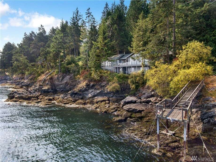 This home at 513 Mineral Point Rd. on San Juan Island is listed for $995,000.The three-bedroom, two-bathroom home spans more than 2,400 square feet, and features floor-to-ceiling windows in the living room and a hot tub enclosed in a room of glass. It also has a 40-foot shared dock and deeded access to a community beach.You can see the full listing here. Photo: Photos By Wes Edholm/listing Courtesy Kelly Snow, Coldwell Banker