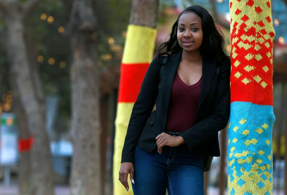 Sheena Lyons walks to her job near the Civic Center in San Francisco. Her training from SVAcademy helped her pursue the field that had captured her interest. Photo: Paul Chinn, The Chronicle