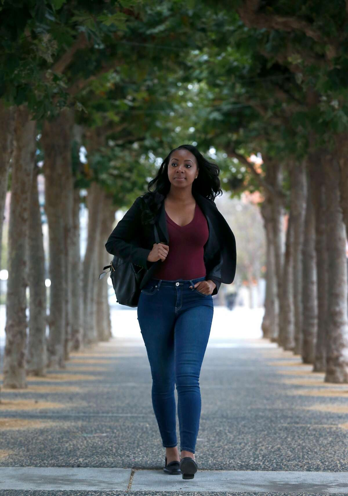 Sheena Lyons walks to her job near the Civic Center in San Francisco, Calif. on Thursday, Aug. 10, 2017 after recently completing vocational training from SVAcademy.